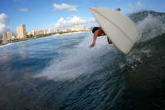 Surfing backside off the lip. A shortboard surfer surfing on a beautiful wave in hawaii stock images