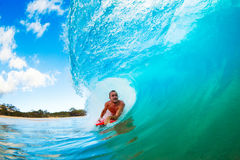 Surfing in the Barrel. Body Boarder on Large Wave Surfing in the Tube Getting Barreled Stock Images