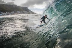 Surfer in a barrel wave Royalty Free Stock Images