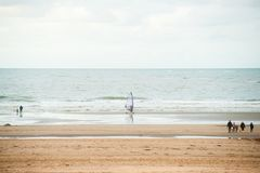 Surfing on the beach Stock Photography