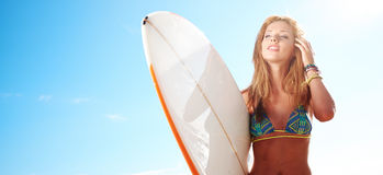 Surfing beautiful woman Stock Photo