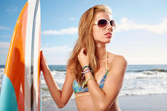 Surfing beautiful woman Royalty Free Stock Photo