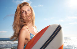Surfing beautiful woman Stock Image