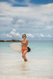 Surfing beautiful woman on the beach Royalty Free Stock Photography