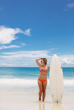Surfing beautiful woman on the beach Stock Photo