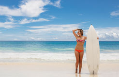 Surfing beautiful woman on the beach Royalty Free Stock Photo