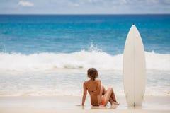 Surfing beautiful woman on the beach Stock Photo