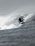Surfing a big barrel Stock Image