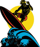 Surfing the big waves Stock Images