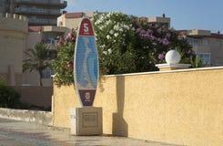 Surfing Board Milestone in La Manga del Mar Menor. Surfing Board Shaped Five Kilometers Touristic Milestone in Main Avenue - La Manga del Mar Menor, Cabo de Stock Photos