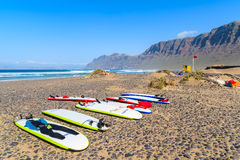Surfing boards on Famara beach Stock Image