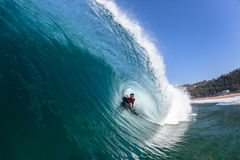 Surfing Body-Boarder Tube Ride Wave Water Stock Images