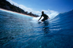 Surfing a Bodyboard in Blue Hawaii Royalty Free Stock Images