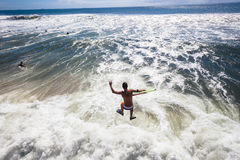 Surfing Bodyboarders Pier Jump Ocean Stock Photo