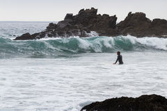 Surfing in California. Pfeiffer Beach, California - May 01 : Male surfer in a full suit surfing on the cold waves of the California coast, May 01 2015 Pfeiffer stock photos