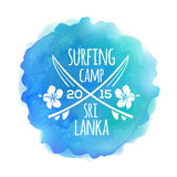 Surfing camp Sri Lanka logo at watercolor splash Royalty Free Stock Photography