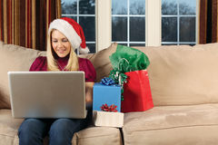 Surfing for Christmas gifts Royalty Free Stock Photo