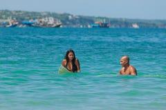 Surfing couple Stock Photos