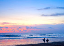 Surfing. Couple. Beach. Couple of surfers walking on the beach on Bali island, Indonesia Royalty Free Stock Photo