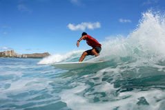 Surfing Cutback. A shortboard surfer doing a cutback on a beautiful wave in hawaii stock image