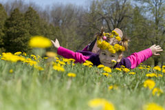 Surfing in dandelion field Royalty Free Stock Photos