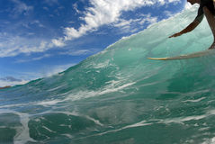 Surfing down the line. A young surfer surfing down the line royalty free stock photo