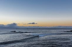 Surfing at Easter Island in front of Hanga Roa royalty free stock photos