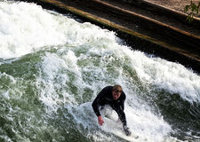 Surfing at Englischer Garden in Munich stock images