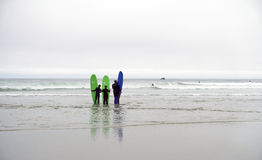Surfing family Royalty Free Stock Photos