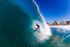 Surfing Fun Wave Water Photo. Touring professional surfer riding inside a clean blue nice size hollow wave at Balito Bay outside Durban. The Surfer athletes come Royalty Free Stock Image