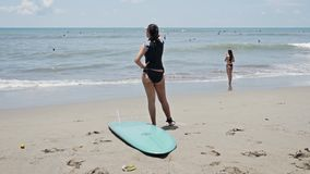 Surfing Girl Checking Spot Bali Indonesia Slowmotion stock video footage