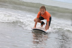 Surfing girl Royalty Free Stock Images