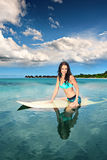 Surfing girl Royalty Free Stock Image