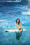 Surfing girl Stock Photography