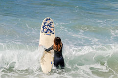 Surfing girl Royalty Free Stock Photography