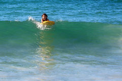 Surfing girl on a wave Stock Photo