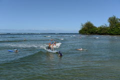 Surfing at Hanalei Bay Stock Image