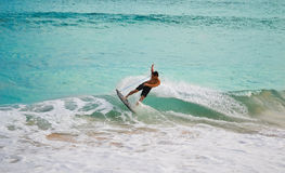 Surfing in hawaii. This pic has been taken in Hawaii (Ohau Island) and this is a surfer on a big wave Stock Photo