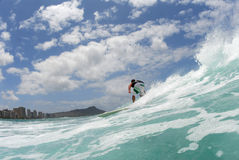 Surfing in Hawaii. A surfer surfing in hawaii royalty free stock photography