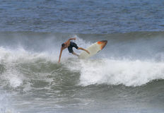Surfing Hawaii. A surfer goes off the top of a wave while surfing in Hawaii Stock Images