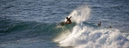 Surfing at Ho'okipa Stock Photography