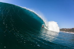Surfing Inside Blue Hollow Crashing Wave stock image