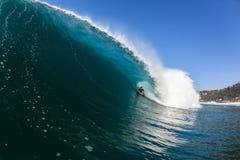 Surfing Inside Blue Hollow Crashing Wave Stock Photo