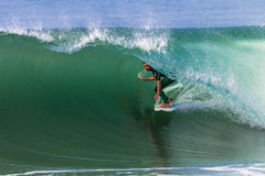 Surfing Rides Inside Wave Royalty Free Stock Photography