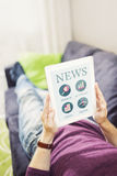 Surfing internet and reading news with digital tablet Stock Images