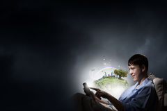 Surfing internet before sleep Stock Photo