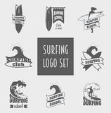 Surfing labels and design elements with surfer, wave and surfboard. Stock Images