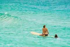 Woman surfing in blue sea Royalty Free Stock Photo
