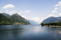 Surfing on the lake. A photo of a lake in the mountains (alps) with surfers royalty free stock photos
