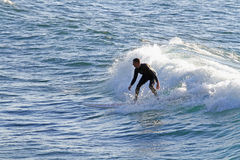 Surfing , Michigan. Surfer catches wave on Lake Superior, Michigan Stock Image